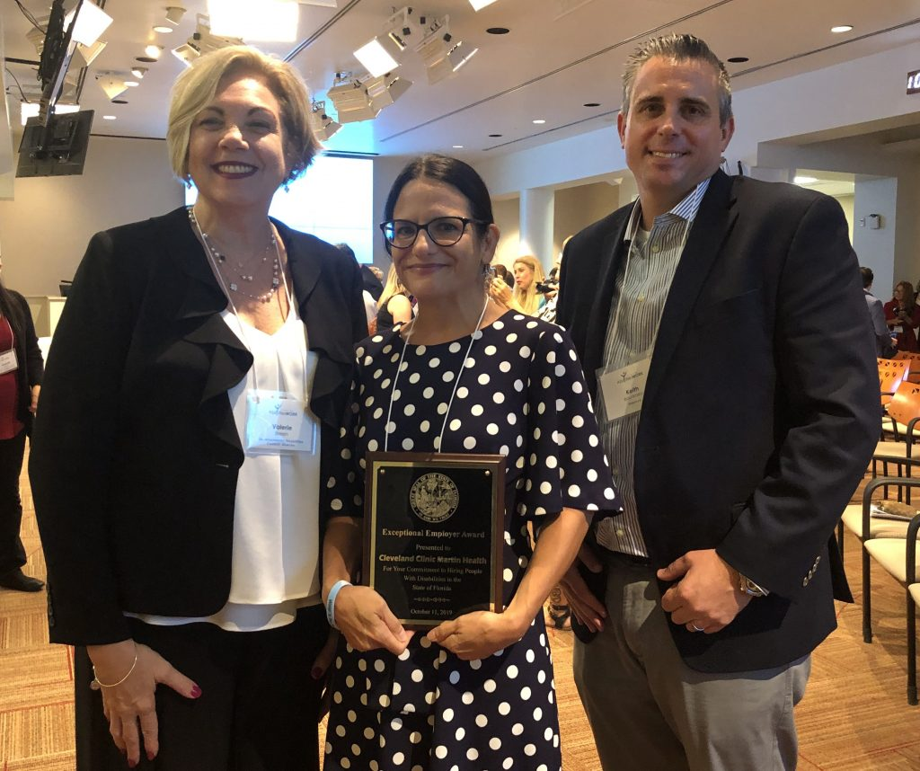 Lindy Sinka receiving Exceptional Employer Award