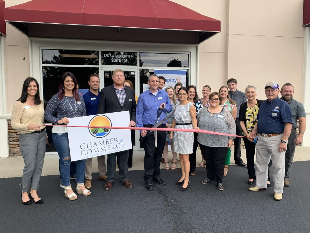 Ribbon being cut for grand opening of office in Lake City