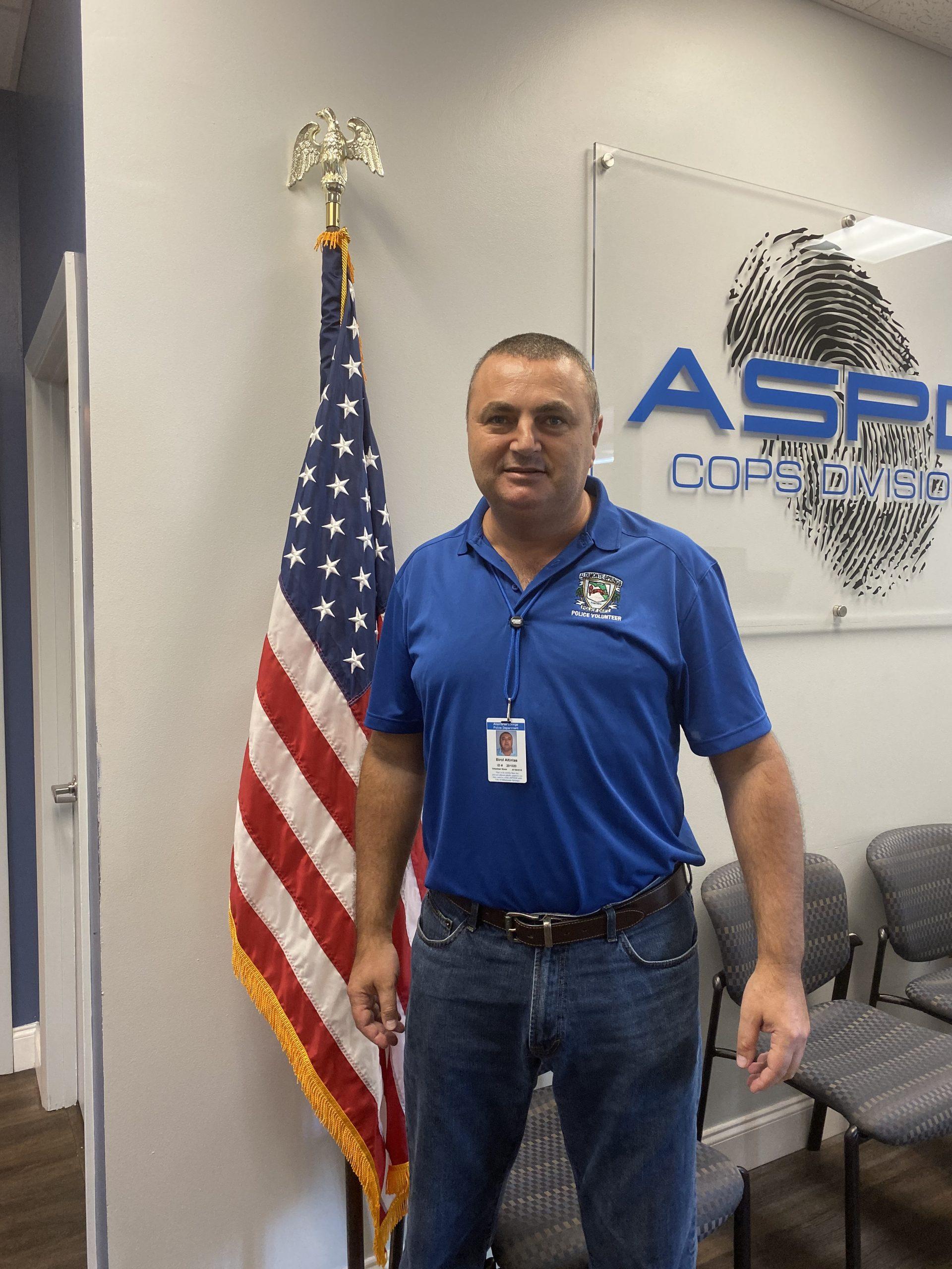 Photo of Birol volunteering in the Altamonte Springs Police Department