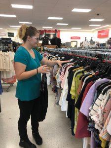 Photo of Aryanna hanging shirts at TJ Maxx