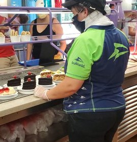 Image of Renee serving customers at a restaurant