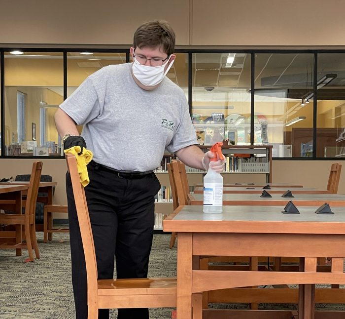 keith cleaning a seating area