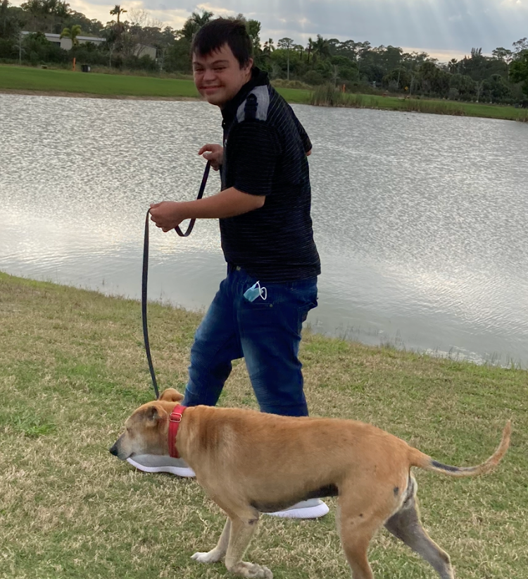 Marc walking dog around lake
