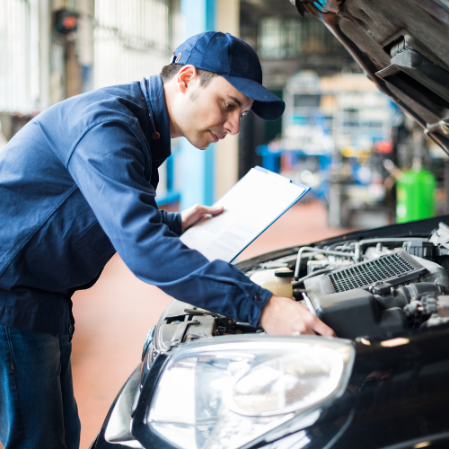 Male mechanic working on car